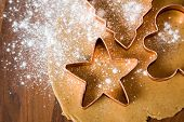 stock photo of christmas cookie  - Baking christmas cookies with star and tree motif - JPG