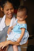 Unknown Mother With Child at Chatuchak Market In Bangkok