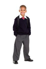 foto of school child  - full length studio portrait of male elementary pupil on white - JPG