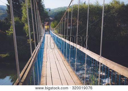 poster of Old Blue Bridge. Travel Photography Of Old Bridge. Crossing Old Wooden Bridge. Old Wooden Bridge. Tr