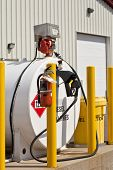 Environmentally safe industrial fuel tanks with safety features such as fire extinguishers and back
