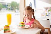 Kids Eat Cake At Restaurant. Little Girl In Cafe. poster