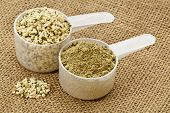 two scoops of raw organic hemp protein powder and shelled hemp seeds - super food rich in nutrients