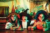 Surprised Group Little Zombie In Halloween Costume Eating Treat - Calaverita Sweets Candles. Funny H poster