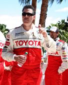 LOS ANGELES - APR 14:  Adam Carolla at the 2012 Toyota Pro/Celeb Race at Long Beach Grand Prix on Ap
