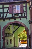 Small Town Kaysersberg , Region Alsace. France. Street Of Medieval Centre With Colorful Half-timbere poster
