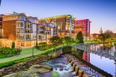 Downtown cityscape of of Greenville, South Carolina, USA on the Reedy River at dusk. poster