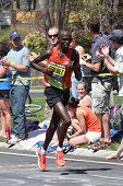 Wilson Chebet races up Heartbreak Hill during the Boston Marathon