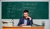 Prepare For Lesson. Teacher Strict Serious Bearded Man Chalkboard Background. Teacher Reading Book.  poster