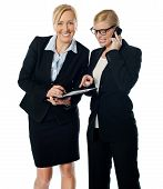 Businesswomen On Call Rectifying The Document