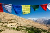 Buddhist prayer flags (lungta) in sky above Spiti valley in Himalayas. Dhankar, Spiti valley, Himach poster