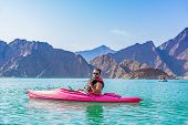 Hatta Kayaking Young Man Kayaking In Hatta Dam Beautiful Place For Water Adventure Activities Like B poster
