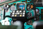 A Inside View Of The Dashboard In Helicopter Pilot Cabin - Pilot Wheel poster