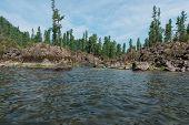 Stone bay on Teletskoye lake in Altai mountains, Siberia, Russia. The lake is a UNESCO World Cultura poster