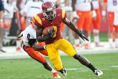 LOS ANGELES - SEP 17: USC Trojans WR Marqise Lee #9 & Syracuse Orange CB Keon Lyn #8 during NCAA Foo