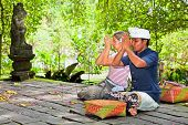 GUNUNG KAWI, BALI, INDONESIA :JANUARY 20: People praying at holy temple  Gunung Kawi during the Nyeg