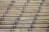 pic of bleachers  - Background image of metal bleachers at football stadium shows rising steps and metal stabilized seating - JPG