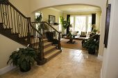 picture of model home  - Luxury home hallway with a tiled floor - JPG