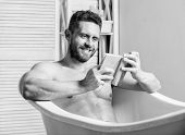 Sexy Man In Bathroom Reading. Macho Naked In Bathtub. Sex And Relaxation Concept. Man Has Muscular B poster