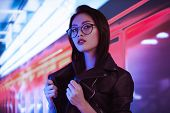 Fashion Beauty Shooting Of Gorgeous Asian Model. Young Beautiful Woman In Black Jacket Posing Over N poster