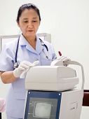 Nurse Cleaning Hospital Equipment