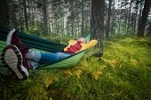 Woman Resting In Hammock Outdoors. Sleeping Outdoors. Relax Time On Holiday Concept Travel. poster
