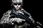 Us Army Soldier With Rifle On Black Background poster