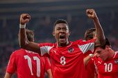 VIENNA,  AUSTRIA - OCTOBER 16: David Alaba (#8 Austria) celebrates after a goal during the WC qualif