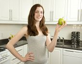 Young Woman Holds Green Apple