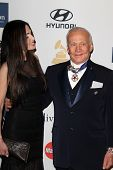LOS ANGELES - FEB 9:  Carolyn Hollingsworth, Buzz Aldrin arrives at the Clive Davis 2013 Pre-GRAMMY
