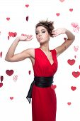 woman in red dress over red hearts background