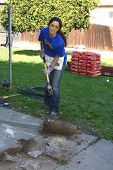 LOS ANGELES - FEB 9:  Theresa Castillo smashes concrete from a removed fence post at the 4th General