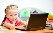 Girl Shows thumb at the laptop