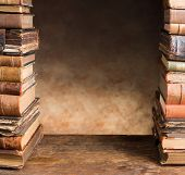 Border frame image of two stacks of antique books