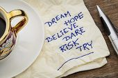 dream, hope, believe, dare, risk, try - motivational words - a napkin doodle with a cup of espresso