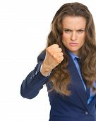 Angry Business Woman Threatening With Fist