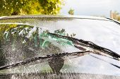 picture of wiper  - outdoor view of auto wipers wash windshield when driving in rain - JPG