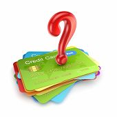 Red query mark on colorful credit cards.