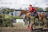 Rostov-on-don, Russia-september 22 - The Horseman On A Horse Jumping Over A Man On A Racetrack In Ro