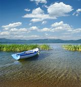 cloudscape on a rowboat moored in Prespa Lake, Republic of Macedonia