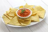 picture of nachos  - tortilla chips with salsa roja dip for super bowl - JPG