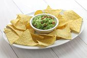 tortilla chips with guacamole dip for super bowl