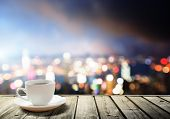 picture of breakfast  - coffee on table in the night city - JPG