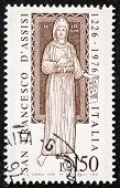 ITALY - CIRCA 1976: a stamp printed in Italy celebrates San Francesco d'Assisi (Saint Francis of Assisi ca.1181 -1226). Italy, circa 1976