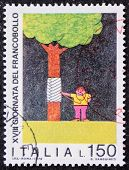 ITALY - CIRCA 1976: a stamp printed in Italy promotes environmental protection depicting a boy auscu