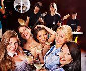 Woman on disco in night club. Lighting effects.