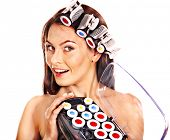 Woman holding hair curlers for head. Isolated.