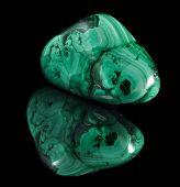 image of malachite  - malachite mineral stone close up  with reflection on black surface background - JPG