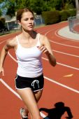 Athletic Woman Running At The Track