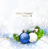 Christmas background with baubles and branches of fir tree.